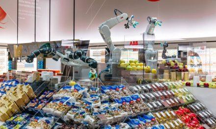 Exposición Robótica ABB con robots sirviendo alimentos
