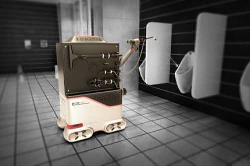 Robot limpia baños utilizando producto químico y agua a presión